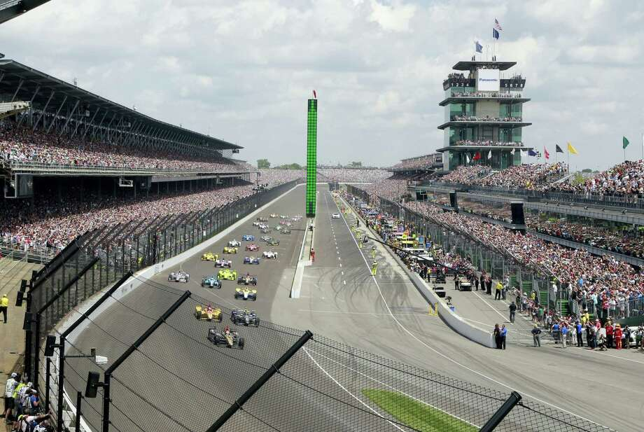 The field rolls into the first turn during the 100th running of the Indianapolis 500 last year. Photo: The Associated Press File Photo  / FR171017 AP