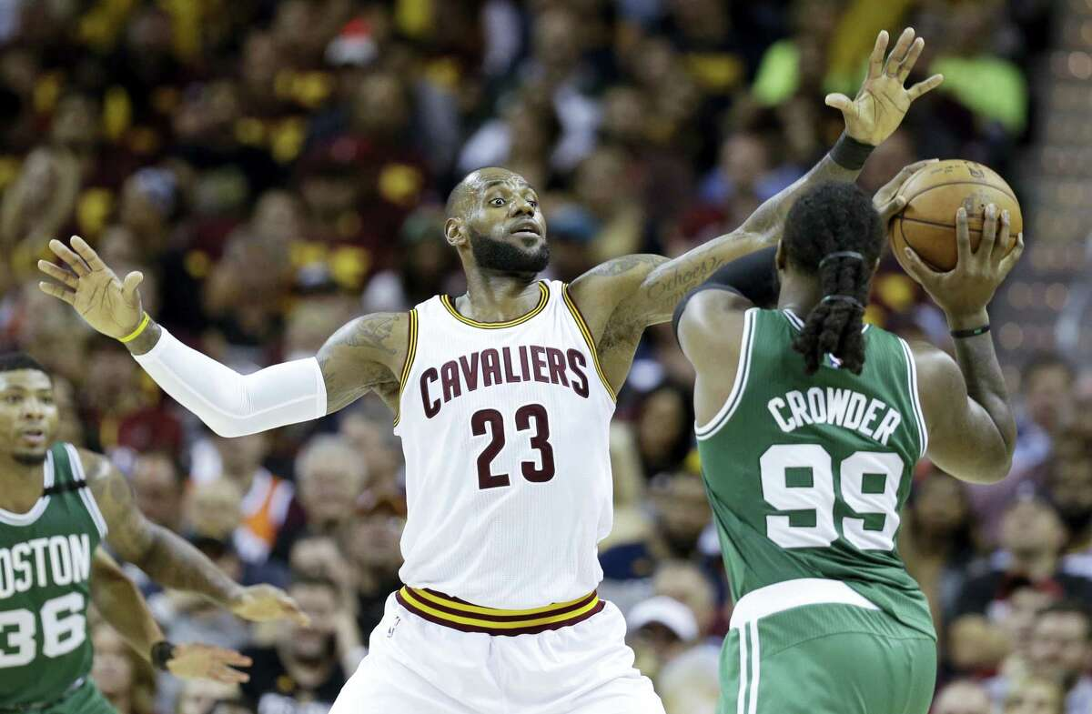 The Cavaliers' LeBron James defends against the Celtics' Jae Crowder during Game 3 on Sunday.