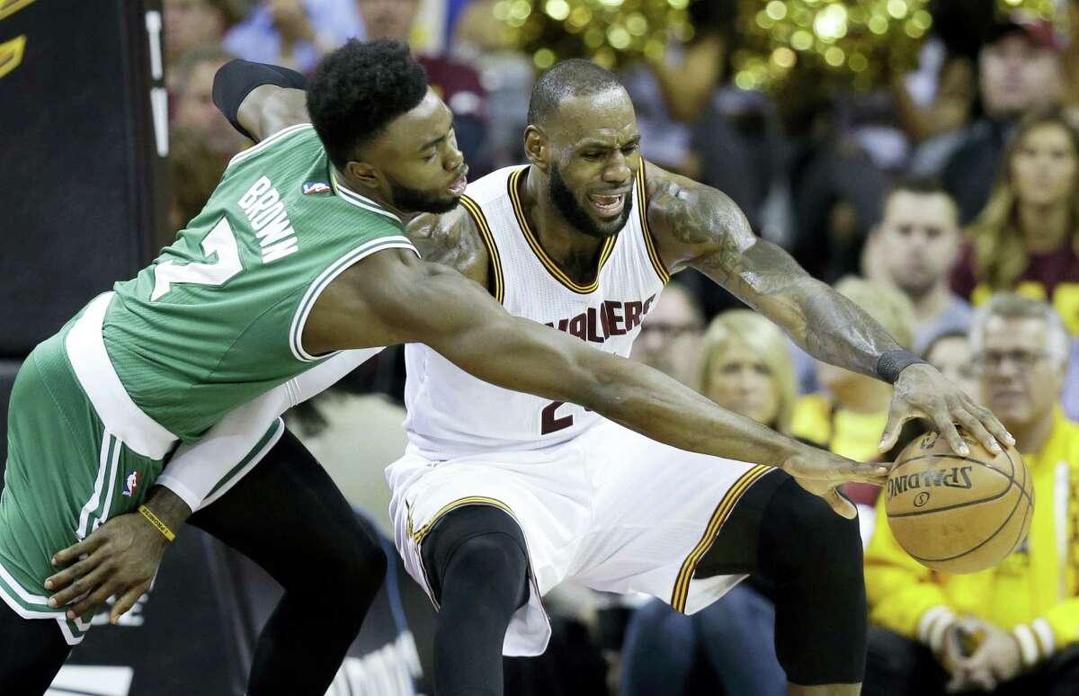 The Celtics' Jaylen Brown, left, defends LeBron James during Game 3 of the Eastern Conference finals on Sunday.