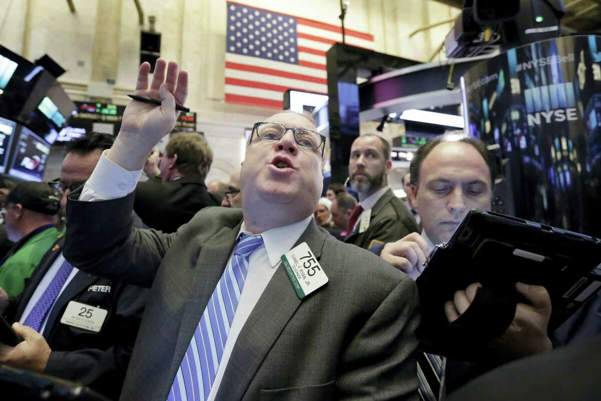 Trader Daniel Ryan works on the floor of the New York Stock Exchange Friday.