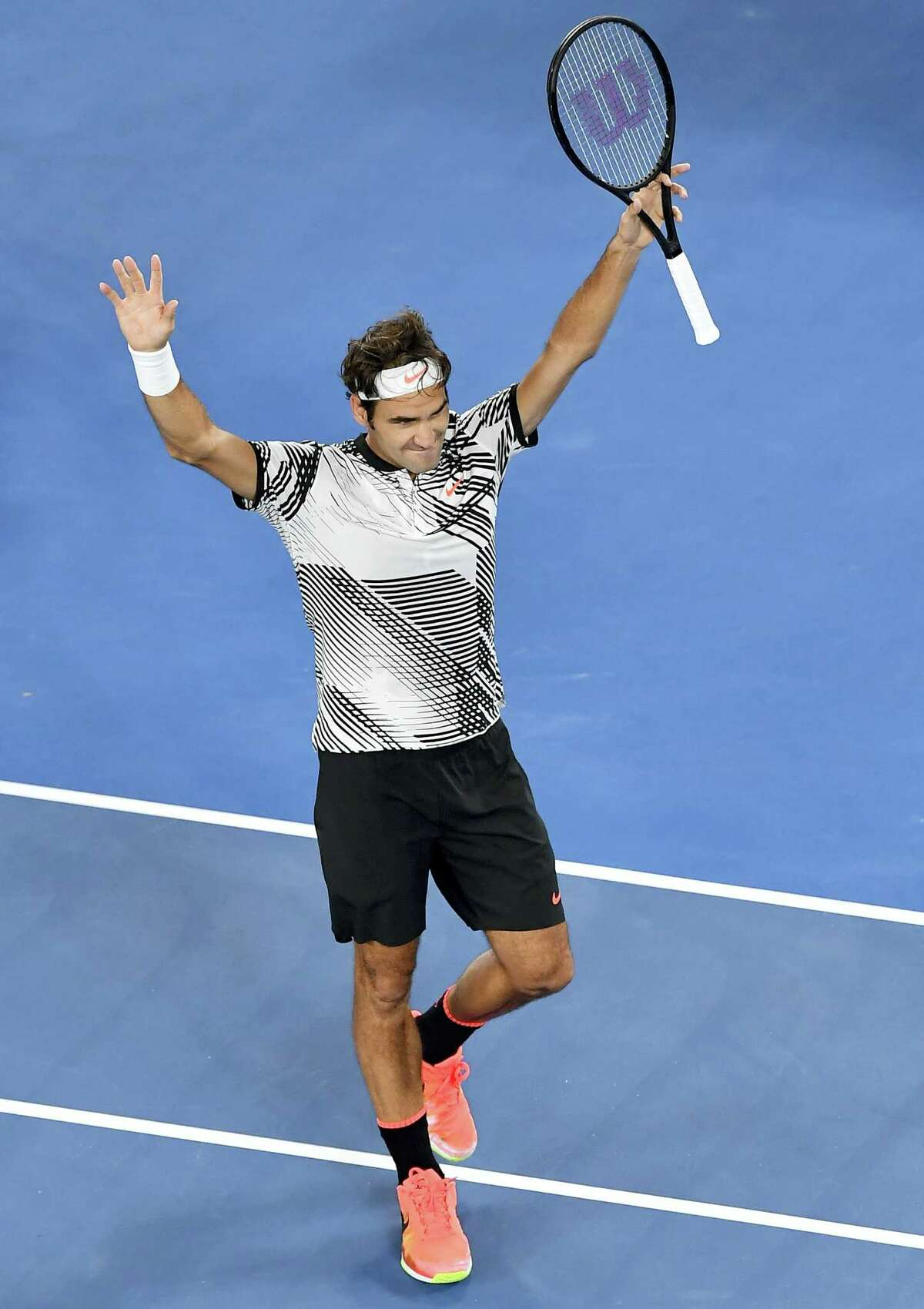 Switzerland's Roger Federer celebrates after defeating compatriot Stan Wawrinka during their semifinal at the Australian Open tennis championships in Melbourne, Australia on Jan. 26, 2017.