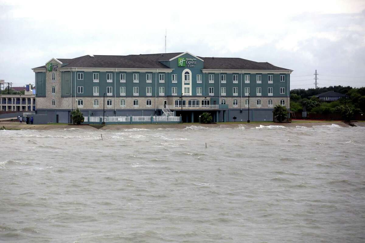 The Holiday Inn and Suites hotel is seen Friday, Aug. 25, 2017. The hotel sits right on the waters of Lavaca Bay. The entire ground floor of the hotel, though, is built with so-called break-away walls which allow a storm surge to pass under the hotel rather than causing it severe damage.