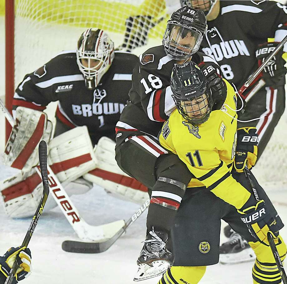 Quinnipiac senior forward Tim Clifton battles Brown's Sam Lafferty in front of the goal during an ECAC Hockey tournament game earlier this month. Photo: Catherine Avlone — Register File Photo  / Catherine Avalone/New Haven Register