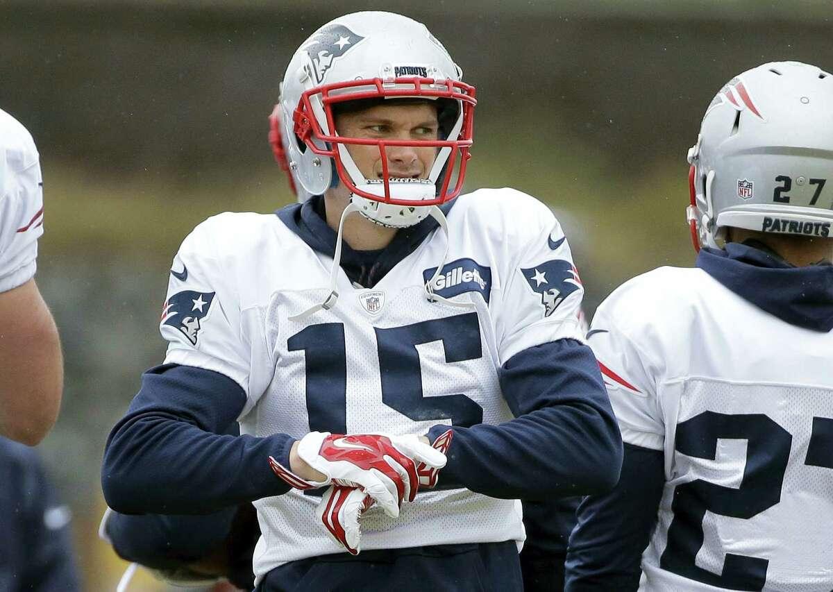 Patriots wide receiver Chris Hogan (15) adjusts his gloves during practice.