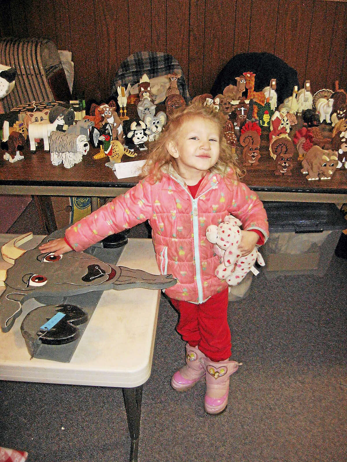 Three-year-old Sierra Charrett of Torrington sees something she likes at the Winchester Grange event Saturday.