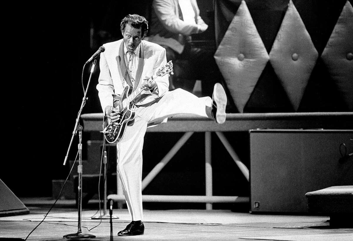 In this Oct. 17, 1986 file photo, Chuck Berry performs during a concert celebration for his 60th birthday at the Fox Theatre in St. Louis, Mo. On Saturday, March 18, 2017, police in Missouri said Berry has died at the age of 90.