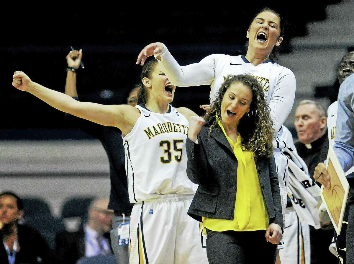 Marquette guard Cristina Bigica (35) and head coach Carolyn Kieger react during a game against Providence in the Big East Conference tournament.