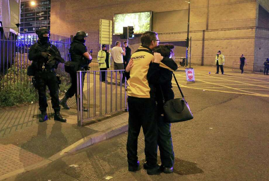 "Armed police stand guard at Manchester Arena after reports of an explosion at the venue during an Ariana Grande gig  in Manchester, England Monday, May 22, 2017. Police says there are ""a number of fatalities"" after reports of an explosion at an Ariana Grande concert in northern England. Photo: Peter Byrne/PA Via AP / The Press Association"