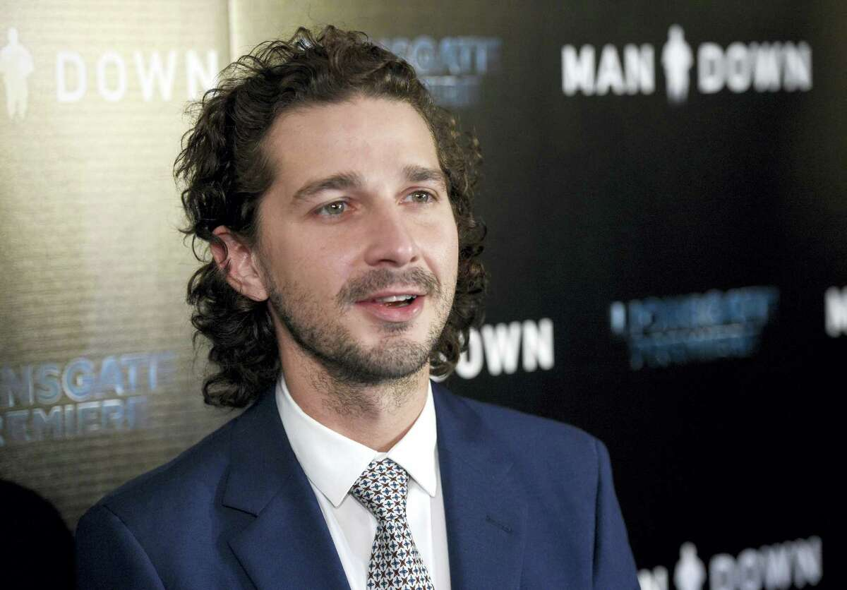 """In this Nov. 30, 2016, file photo, Shia LaBeouf arrives at the Los Angeles premiere of """"Man Down"""" at ArcLight Cinemas Hollywood. LaBeouf has been arrested early Thursday morning, Jan. 26, 2017, after he allegedly got into an altercation with another man outside a New York City museum. Police say LaBeouf pulled the scarf of an unidentified 25-year-old man early Thursday morning outside the Museum of the Moving Image in Queens, scratching the man's face in the process."""