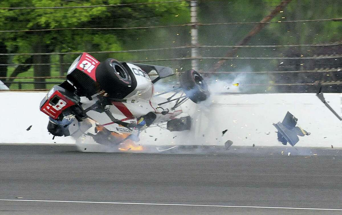The car driven by Sebastien Bourdais, of France, impacts the wall in the second turn during qualifications for the Indianapolis 500 IndyCar auto race at Indianapolis Motor Speedway on Saturday, May 20, 2017 in Indianapolis.