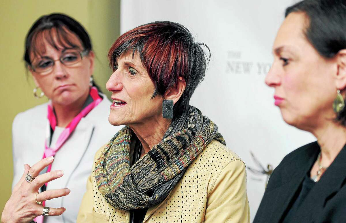 Tammy Sneed, left, director of Girls' Services for the Connecticut Department of Children and Families, and DCF Commissioner Joette Katz, right, listen to U.S. Rep. Rosa DeLauro speak about the problem of sex trafficking in New Haven in 2014.