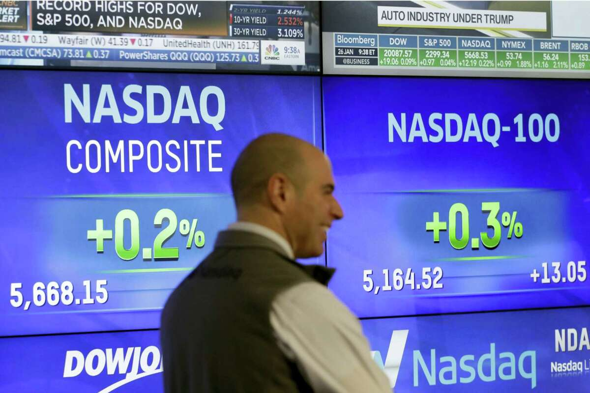 Screens for the Nasdaq Composite and Nasdaq-100 are displayed at Nasdaq, Thursday, Jan. 26, 2017, in New York.