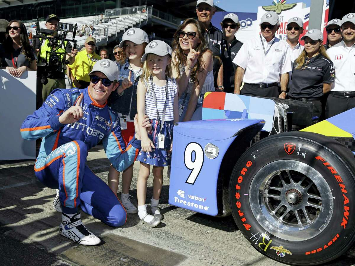 Scott Dixon, of New Zealand, celebrates with his wife, Emma, and children, Poppy and Tilly, after winning the pole for the Indianapolis 500 IndyCar auto race at Indianapolis Motor Speedway, Sunday in Indianapolis.