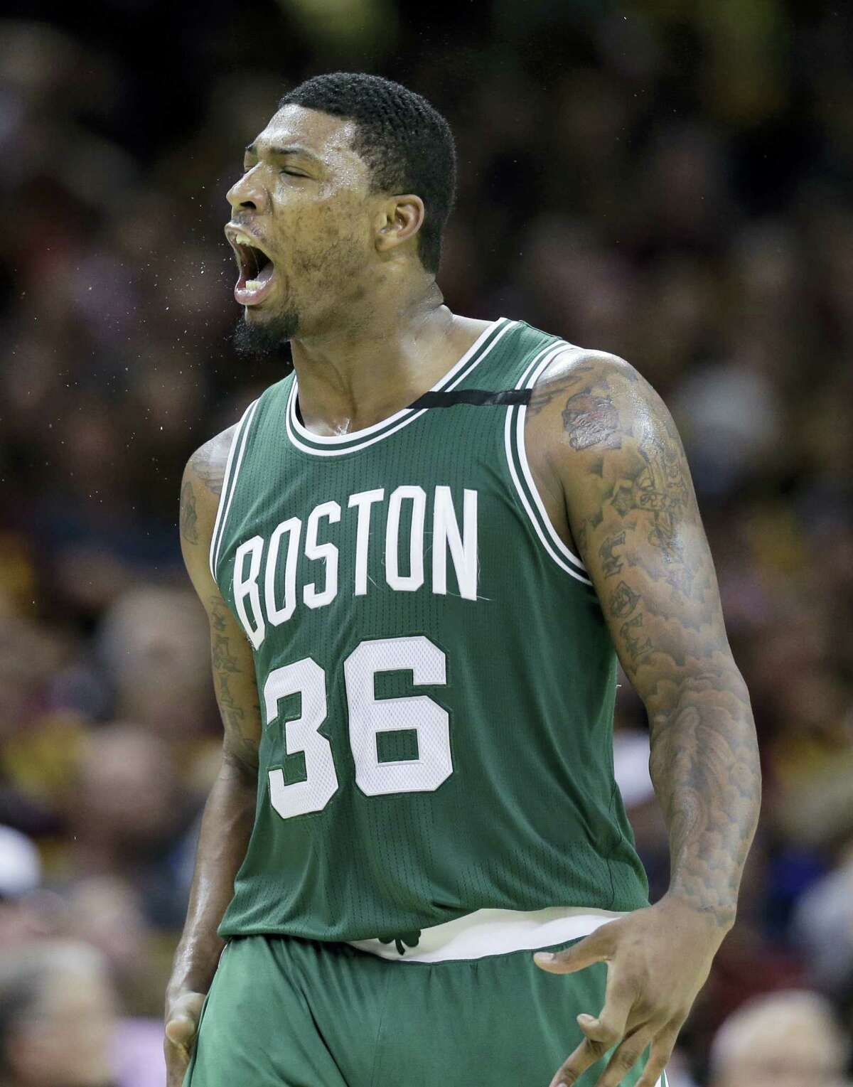 The Celtics' Marcus Smart (36) reacts after hitting a 3-pointer against the Cavaliers on Sunday.