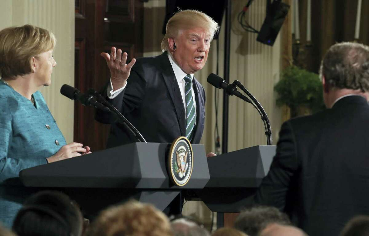 President Donald Trump, joined by German Chancellor Angela Merkel, left, speaks during a joint news conference in the East Room of the White House in Washington, Friday.