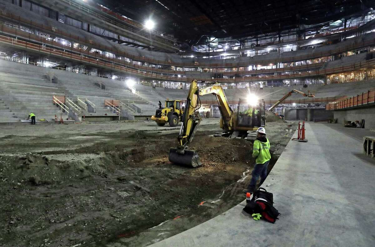 In this Jan. 3, 2017 photo, workers for RBV Contracting Inc., a subcontractor of Cimco Refrigeration Inc., begin excavation for the ice system at Little Caesars Arena, future home of the Detroit Red Wings hockey team and Detroit Pistons basketball team in Detroit. Rollout of the Government Accounting Standards Board's reporting rules for economic development tax breaks has not been without hiccups, with the nonprofit board issuing an April 2017 clarification about tax increment financing, or TIF, districts. The mechanism was used to develop Little Caesars Arena and other projects nationwide.