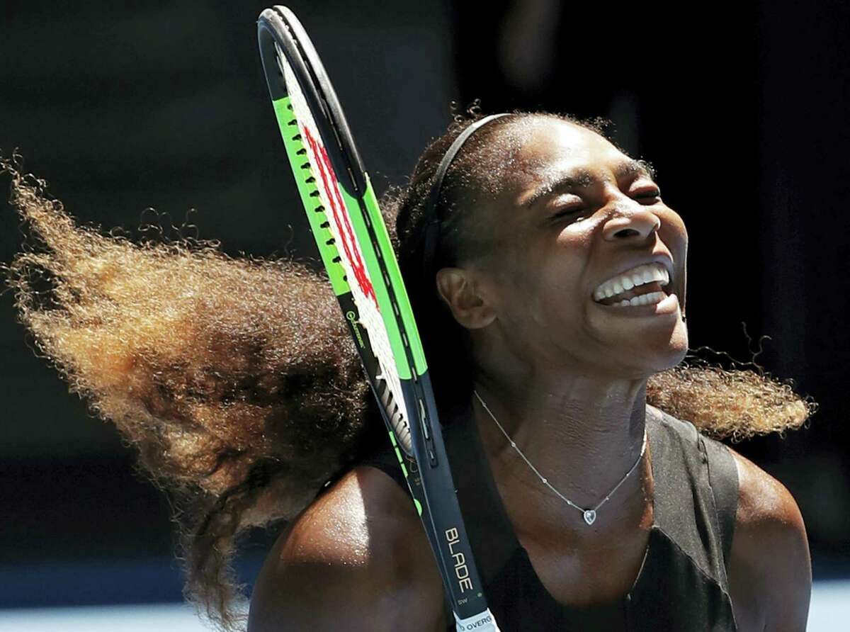 United States' Serena Williams celebrates her win over Britain's Johanna Konta during their quarterfinal at the Australian Open tennis championships in Melbourne, Australia on Jan. 25, 2017.