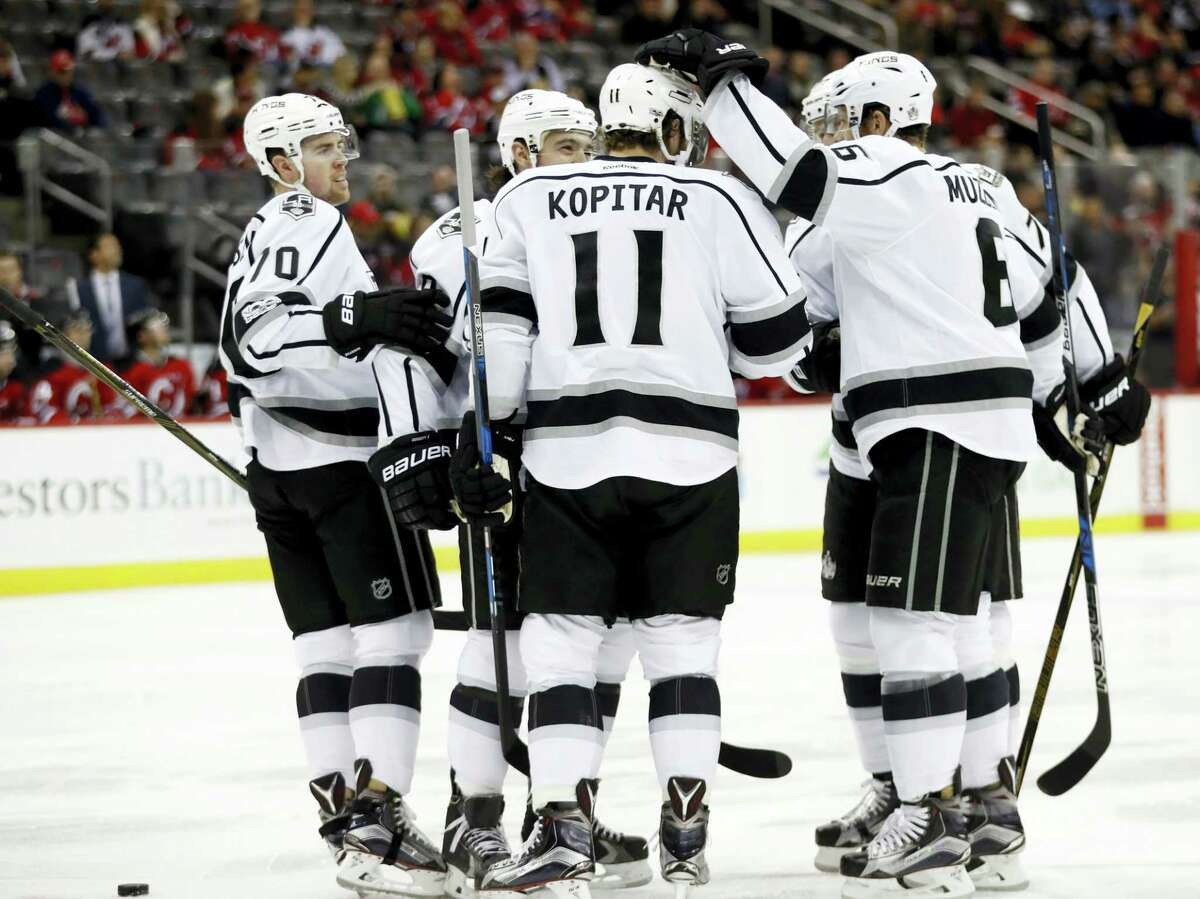 Los Angeles Kings players celebrate a goal by Anze Kopitar (11), of Slovenia, against the New Jersey Devils during the first period of an NHL hockey game on Jan. 24, 2017 in Newark, N.J.