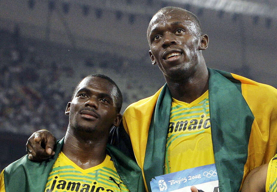In this Aug. 22, 2008 photo, members of Jamaica's gold medal winning relay team Nesta Carter and Usain Bolt, right, celebrate after the men's 4x100-meter relay final during the athletics competitions in the National Stadium at the Beijing 2008 Olympics in Beijing. Bolt has been stripped of one of his nine Olympic gold medals on Jan. 25, 2017 in a doping case involving teammate Nesta Carter. Photo: AP Photo/Anja Niedringhaus, File  / AP2008
