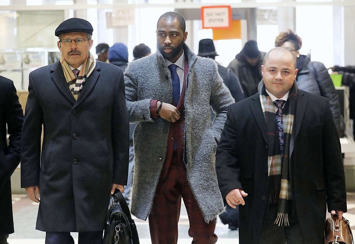 Former New York Jets cornerback Darrelle Revis, center, arrives at Municipal Court in Pittsburgh, Wednesday, March 15, 2017. Revis is in court on charges alleging he was in a fight with two men in Pittsburgh last month. (Andrew Rush/Pittsburgh Post-Gazette via AP)