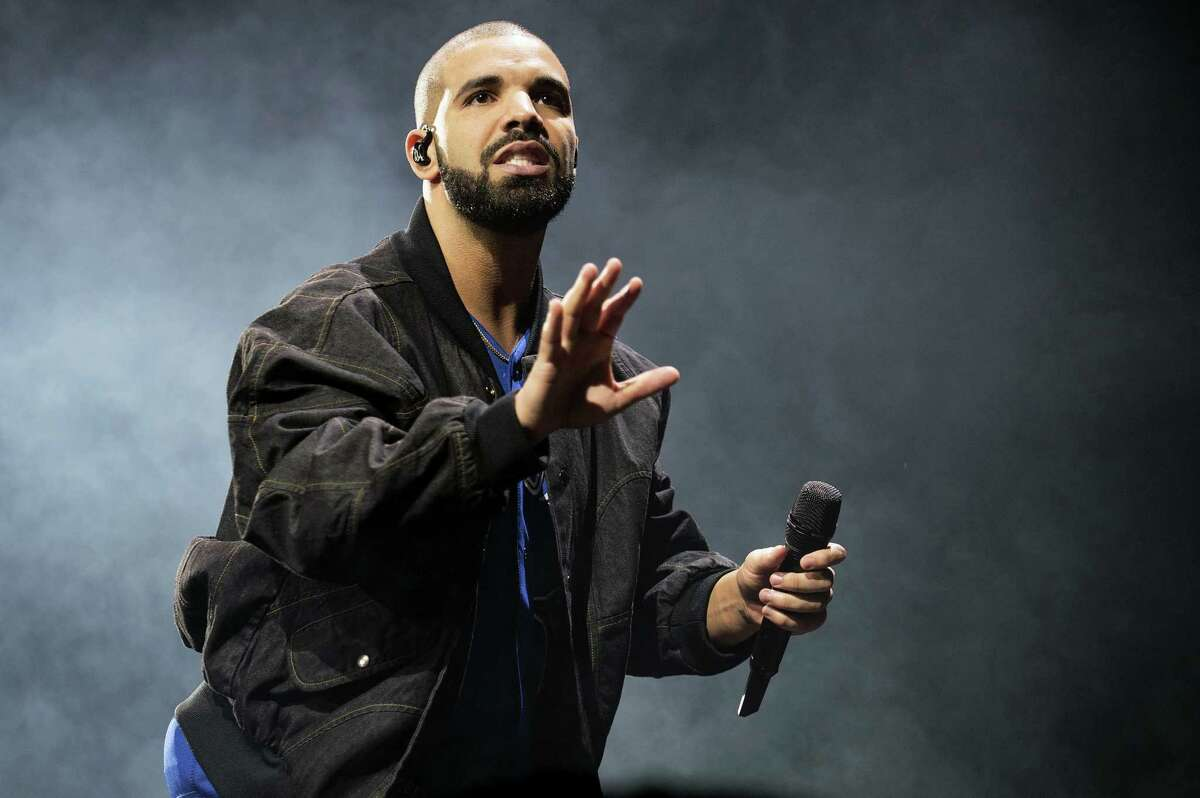 In this Oct. 8, 2016 photo, Drake performs on stage in Toronto, Canada. Drake and the Chainsmokers are on track to own the night at the 2017 Billboard Music Awards on Sunday, May 21 in Las Vegas. The rapper and electronic dance duo are the top contenders at Sunday's show with 22 nominations each.