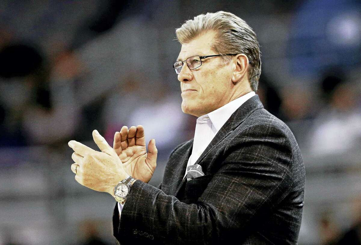 Connecticut head coach Geno Auriemma applauds his team during the second half of an NCAA college basketball game against East Carolina in Greenville, N.C., Tuesday, Jan. 24, 2017.