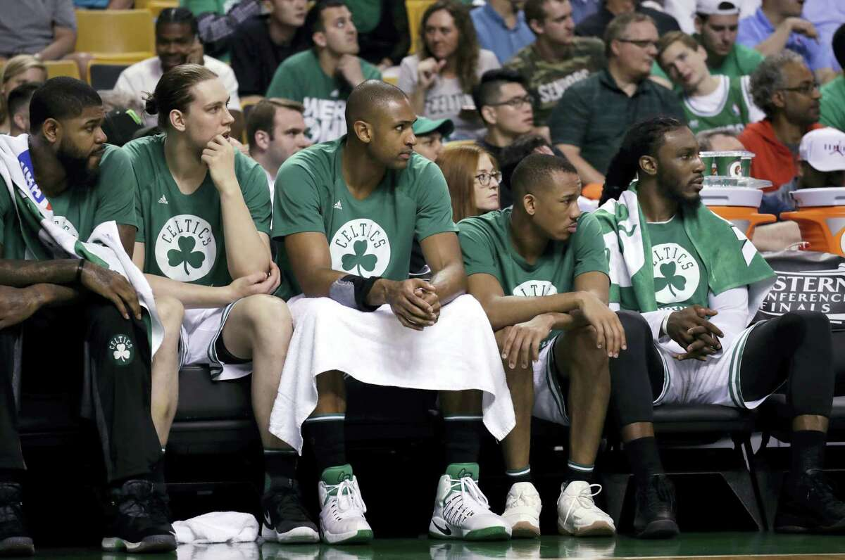 Boston Celtics players watch from the bench during the second half of Game 2 of the Eastern Conference finals Friday in Boston.