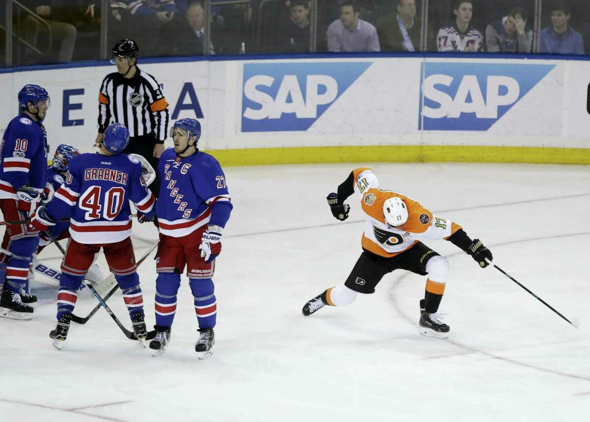 Philadelphia Flyers' Wayne Simmonds (17) celebrates after scoring a goal as New York Rangers' J.T. Miller (10), Ryan McDonagh (27) and Michael Grabner (40) react during the third period of an NHL hockey game Wednesday in New York. The Flyers won 2-0.