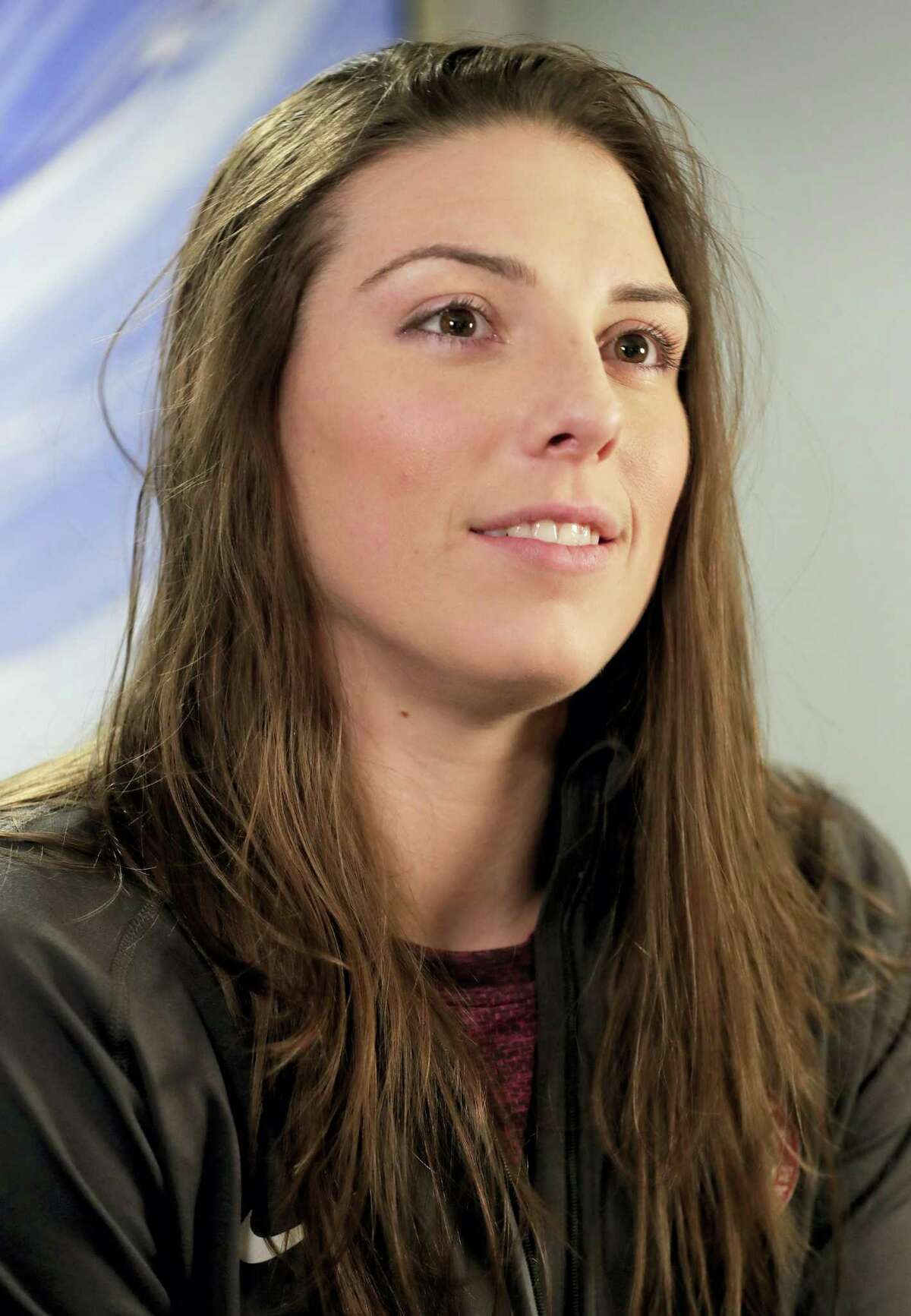 In this Feb. 7, 2017 photo, WNHL player Hilary Knight answers questions during an interview in New York. The U.S. women's hockey team is threatening to boycott the world championships because of a wage dispute. The team announced Wednesday that they will not participate in the International Ice Hockey Federation tournament that begins March 31, 2017 in Plymouth, Michigan.