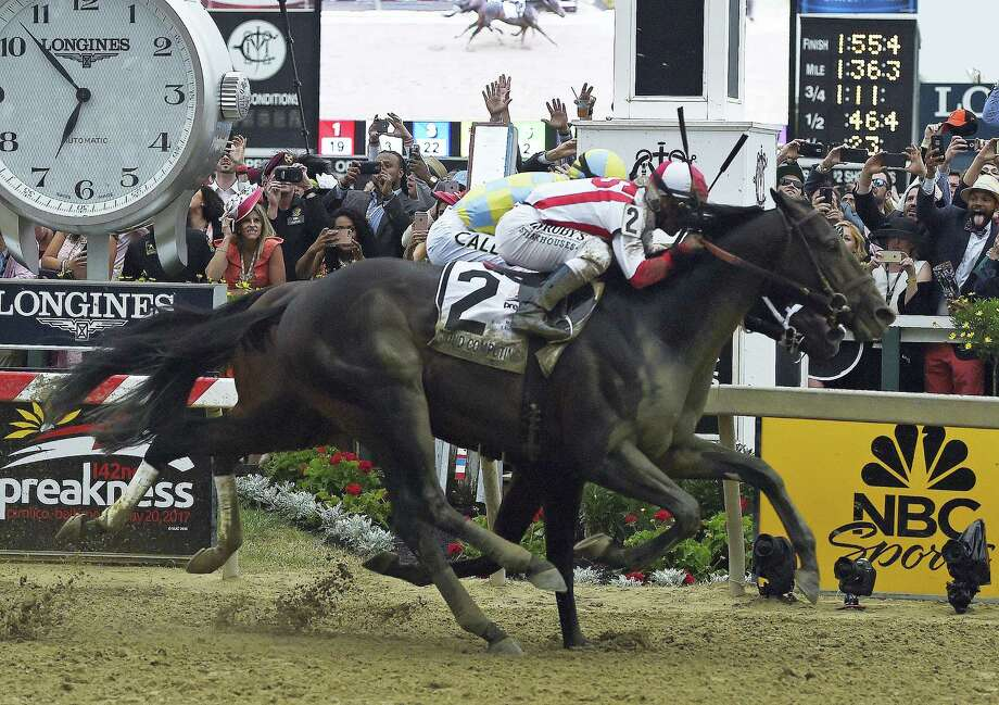 Cloud Computing (2) wins the 142nd Preakness Stakes ahead of Classic Empire Saturday at Pimlico Race Course in Baltimore. Photo: Mike Stewart — The Associated Press  / Copyright 2017 The Associated Press. All rights reserved.