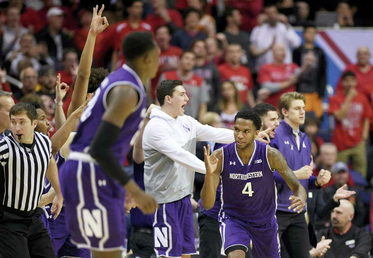Northwestern forward Vic Law (4) gestures during the second half of the team's NCAA college basketball game against Maryland in the Big Ten tournament on March 10, 2017 in Washington. Northwestern won 72-64.