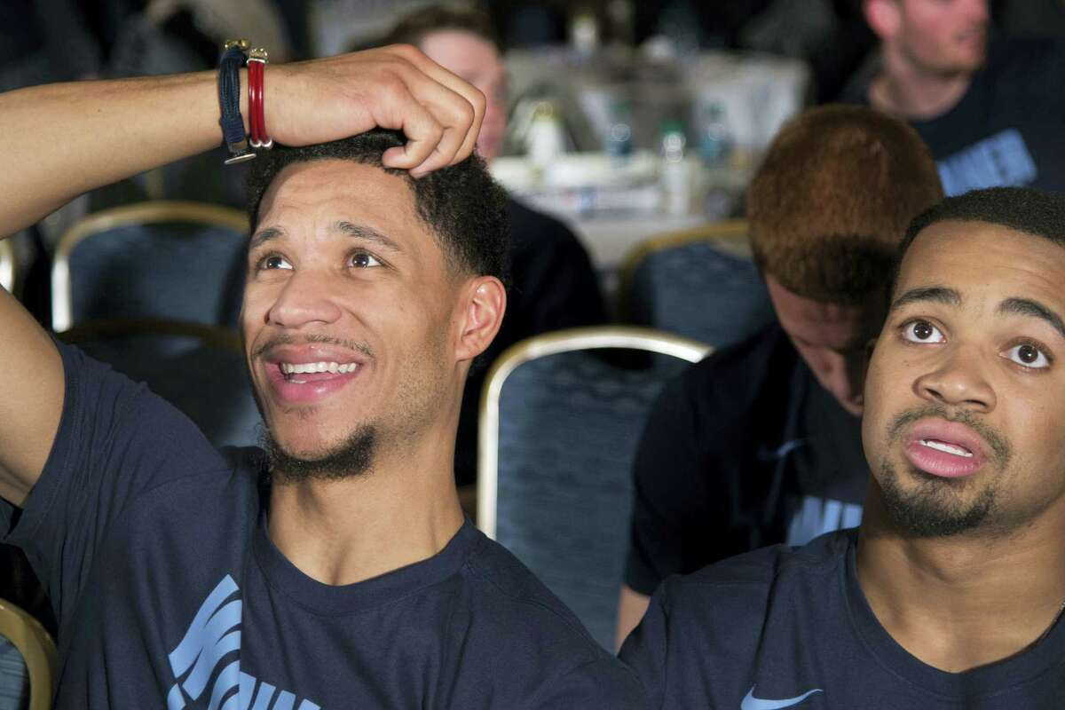 Villanova's Josh Hart, left, and Phil Booth watch the broadcast of the NCAA men's basketball tournament selection show Sunday, March 12, 2017, in Philadelphia.