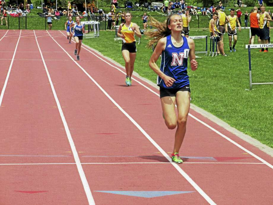 Three-time winner Mary Bibbey finishes the 3,200 meters for another individual Nonnewaug win Saturday at the Berkshire League championships. Photo: Photo By Peter Wallace