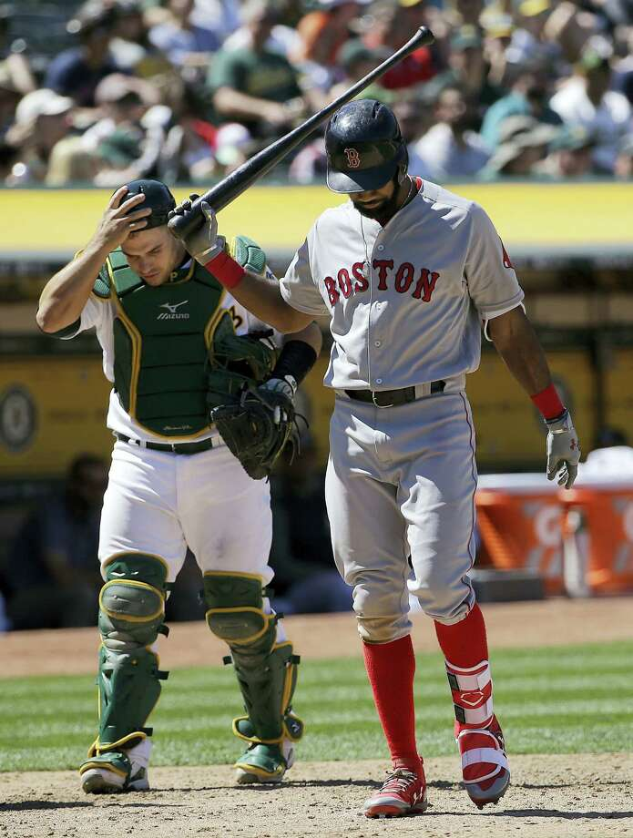 The Red Sox's Chris Young, right, reacts after striking out in the sixth inning Saturday. Photo: Jeff Chiu — The Associated Press  / Copyright 2017 The Associated Press. All rights reserved.