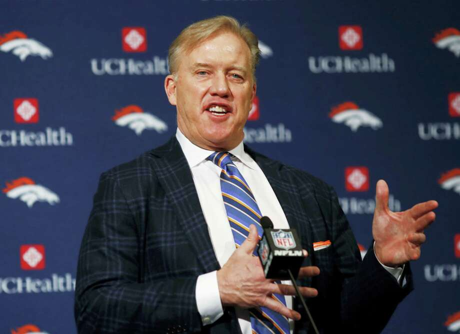 Denver Broncos general manager John Elway responds to questions after the introduction of Vance Joseph as the new head coach of the NFL football team during a news conference at the team's headquarters. A Washington, D.C., cab driver got the surprise of a lifetime after mentioning to a group of passengers that John Elway was his all-time favorite quarterback and then learning that Elway himself was riding in the backseat. Photo: David Zalubowski — AP File Photo  / Copyright 2017 The Associated Press. All rights reserved.