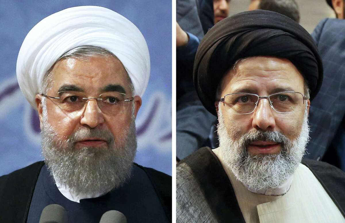 This combination of two Friday, April 14, 2017 file photos shows Iranian President Hassan Rouhani, left, and Iranian cleric Ebrahim Raisi when they register their candidacies for the May 19 presidential elections at the Interior Ministry in Tehran. Iran's state television declared incumbent President Rouhani the winner of the country's presidential election on Saturday, May 20, giving the 68-year-old cleric a second four-year term to see out his agenda calling for greater freedoms and outreach to the wider world. His nearest challenger was hard-line cleric Raisi, with 15.5 million votes. He is close to Ayatollah Ali Khamenei, Iran's supreme leader, who stopped short of endorsing anyone in the election.