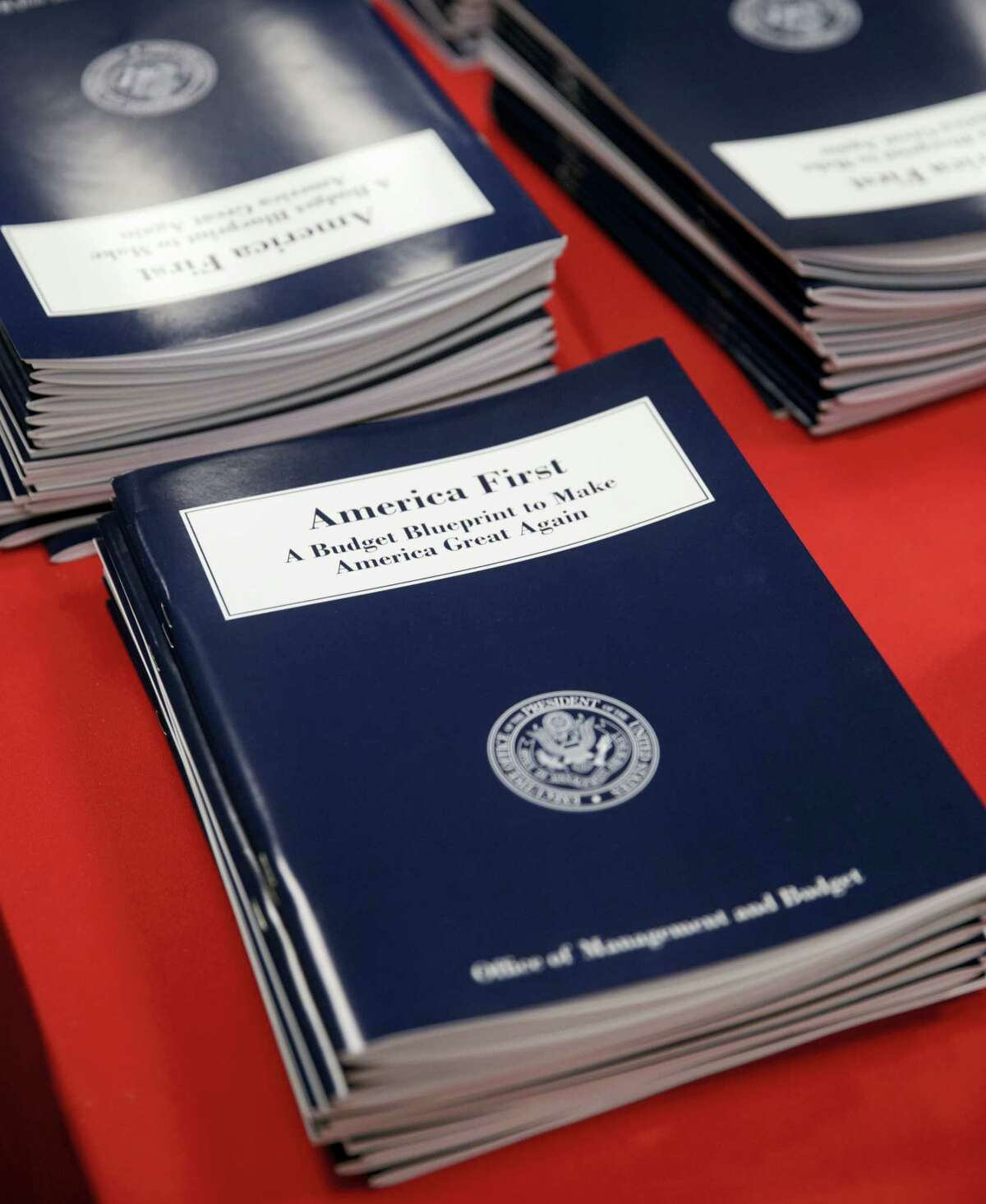 Copies of President Donald Trump's first budget are displayed at the Government Printing Office in Washington, Thursday, March, 16, 2017. Trump unveiled a $1.15 trillion budget on Thursday, a far-reaching overhaul of federal government spending that slashes many domestic programs to finance a significant increase in the military and make a down payment on a U.S.-Mexico border wall.