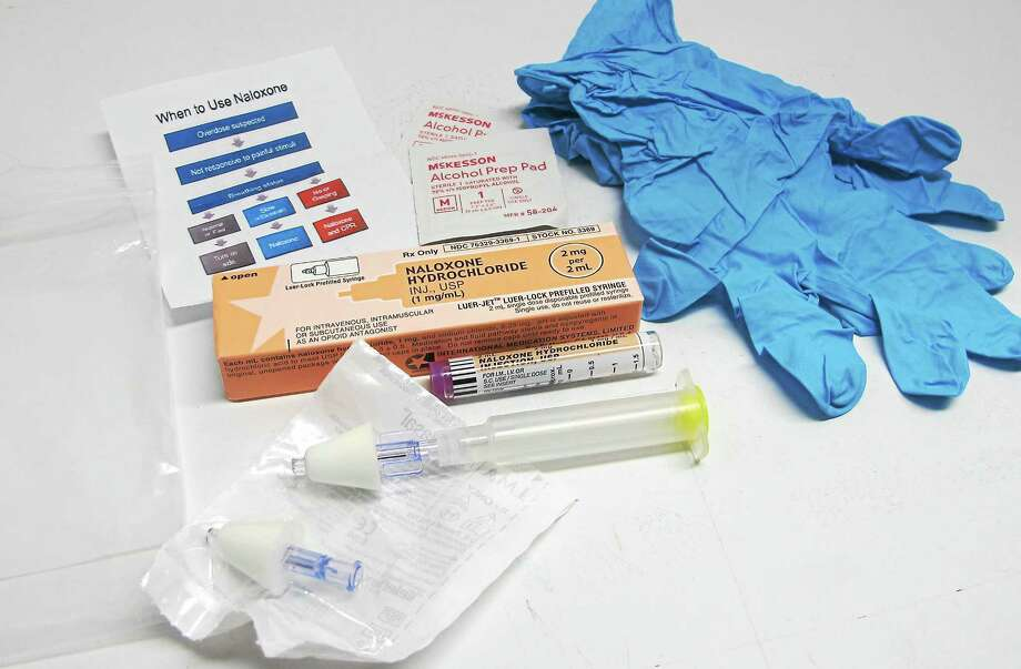 In this May 13, 2015 photo, the contents of a drug overdose rescue kit is seen at a training session in Buffalo, N.Y., on how to administer naloxone, which reverses the effects of heroin and prescription painkillers. New York and other states have been equipping lay people, as well first responders and families of addicts, with naloxone in an effort to increase the chances it will be there when needed. Photo: AP Photo — Carolyn Thompson  / AP