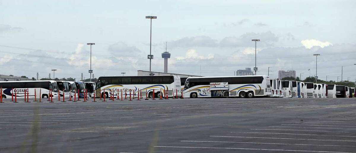 Buses arrive at the AT&T Center parking lot as hurricane preparation continues in San Antonio on August 25, 2017.
