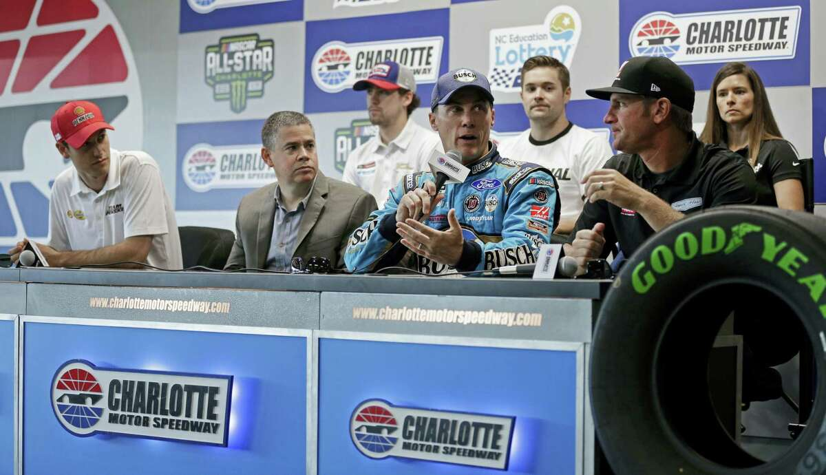 John Entz, FOX Sports President & Executive Producer, Production, second from left, listens during a news conference with NASCAR drivers at Charlotte Motor Speedway in Concord, N.C.