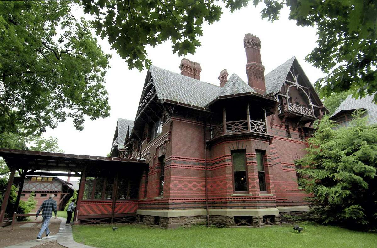 """In this June 4, 2008, file photo, visitors enter The Mark Twain House and Museum in Hartford, Conn. Notes that Twain jotted down from a fairy tale he told his daughters more than a century ago when living in Hartford, Conn., have inspired a new children's book, """"The Purloining of Prince Oleomargarine,"""" set to be published in September 2017. The contract for the book was steered through the Mark Twain House and Museum in Hartford as a way to provide a financial lift for the museum."""