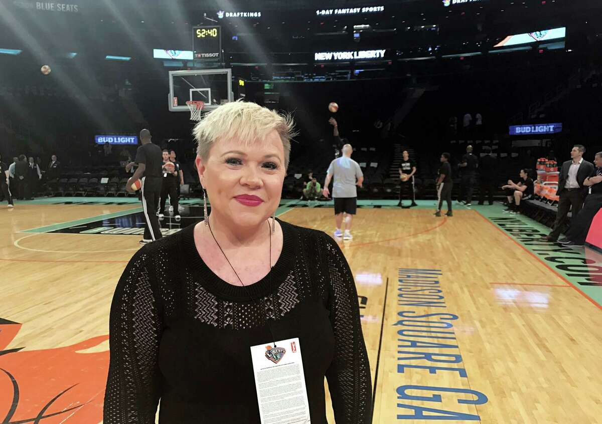 Holly Rowe stands on the court at Madison Square Garden in New York.