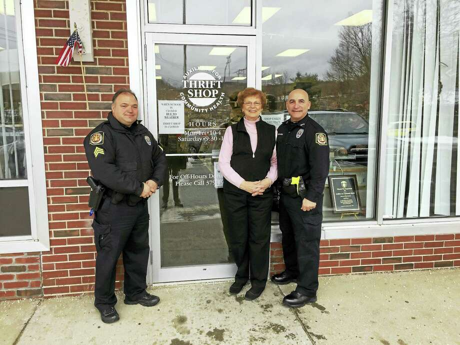 Ben Lambert - The Register Citizen  Milly Hudak of the Auxiliary for Community Health and Officers Robert Varasconi and Daniel Pietrafesa of the Winchester Police Department met outside of the auxiliary thrift shop Wednesday to receive a donation from the group for the D.A.R.E. program. Photo: Digital First Media