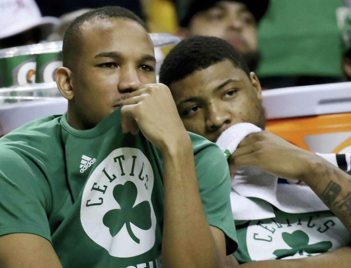 Celtics guards Avery Bradley, left, and Marcus Smart watch from the bench on Friday.