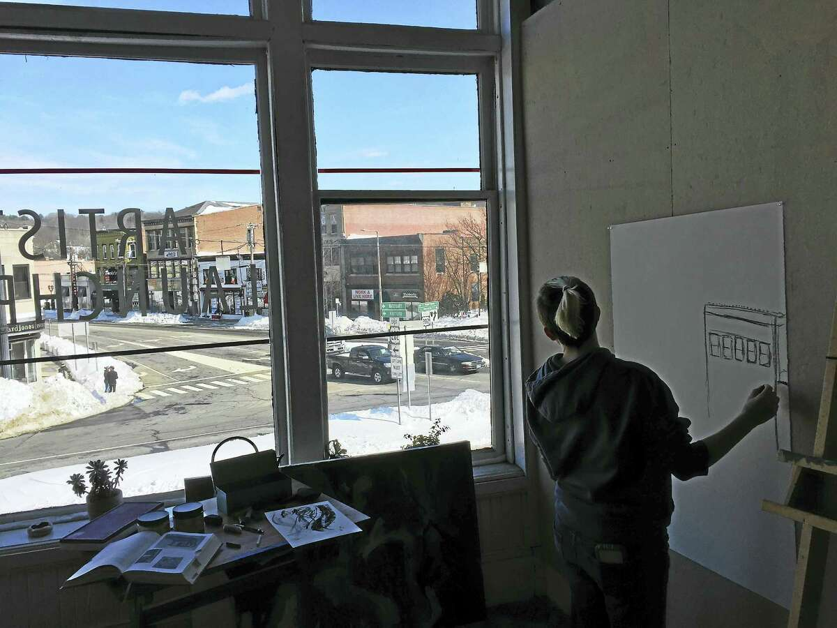 Macayla Muzzulin gazes out at the city Thursday in the Launchpad studio space above the Five Points Gallery in downtown Torrington.
