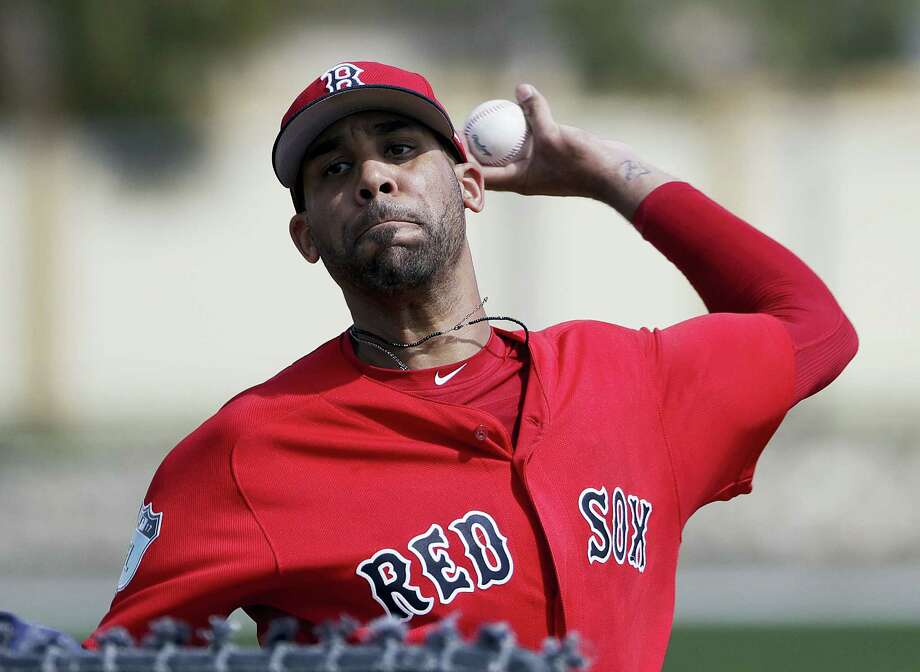 In this file photo, Boston Red Sox pitcher David Price throws a live batting session at a spring training baseball workout in Fort Myers, Fla. Price is likely to start the season on the disabled list because of his sore pitching elbow. Starting the second season of a $217 million, seven-year contract, Price has not yet appeared in an exhibition game. Photo: David Goldman — The Associated Press File  / Copyright 2017 The Associated Press. All rights reserved.