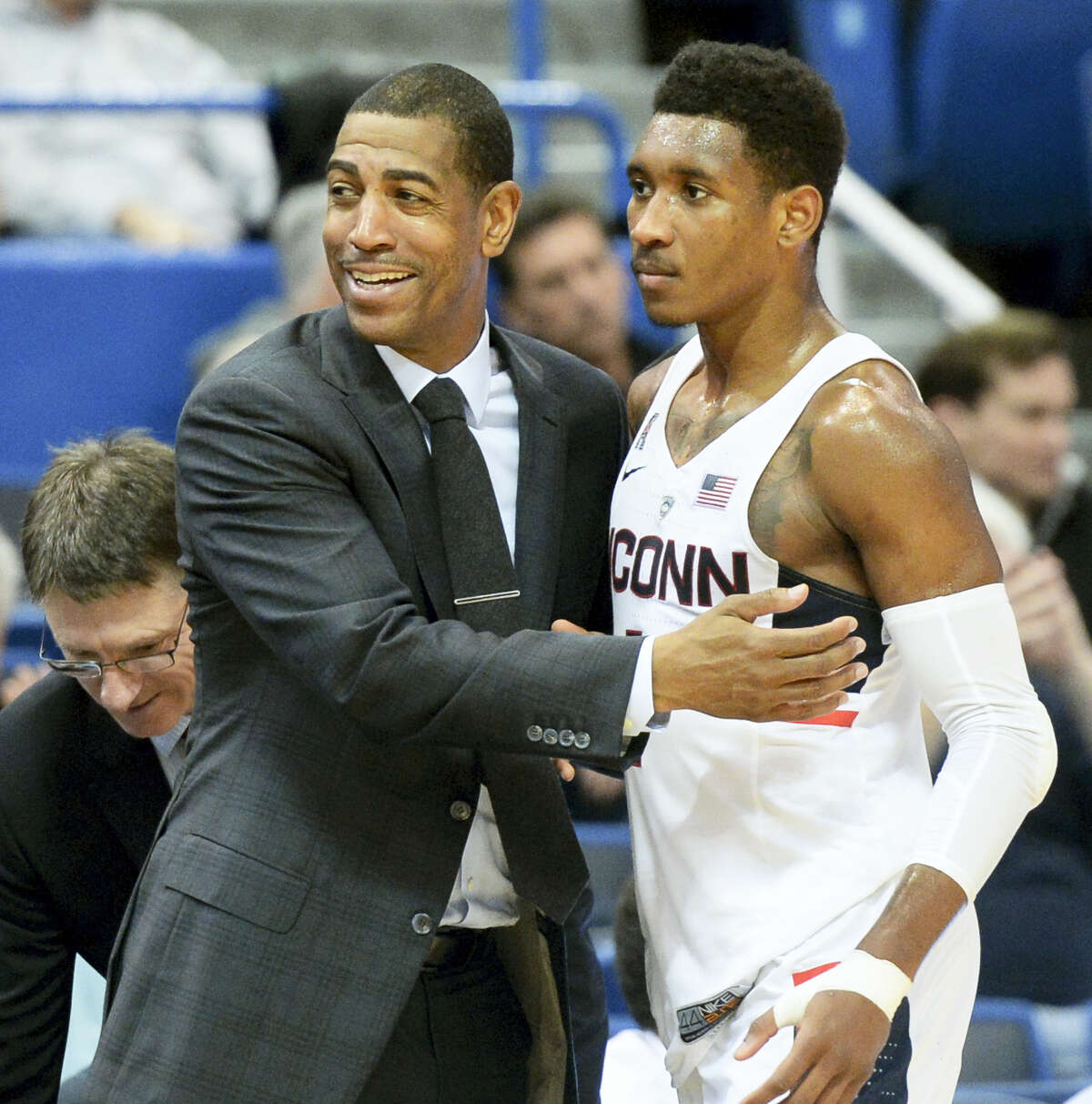 UConn men's basketball head coach Kevin Ollie congratulates Jalen Adams (2) at the end of the game against East Carolina Sunday. The Huskies beat South Florida 81-60.