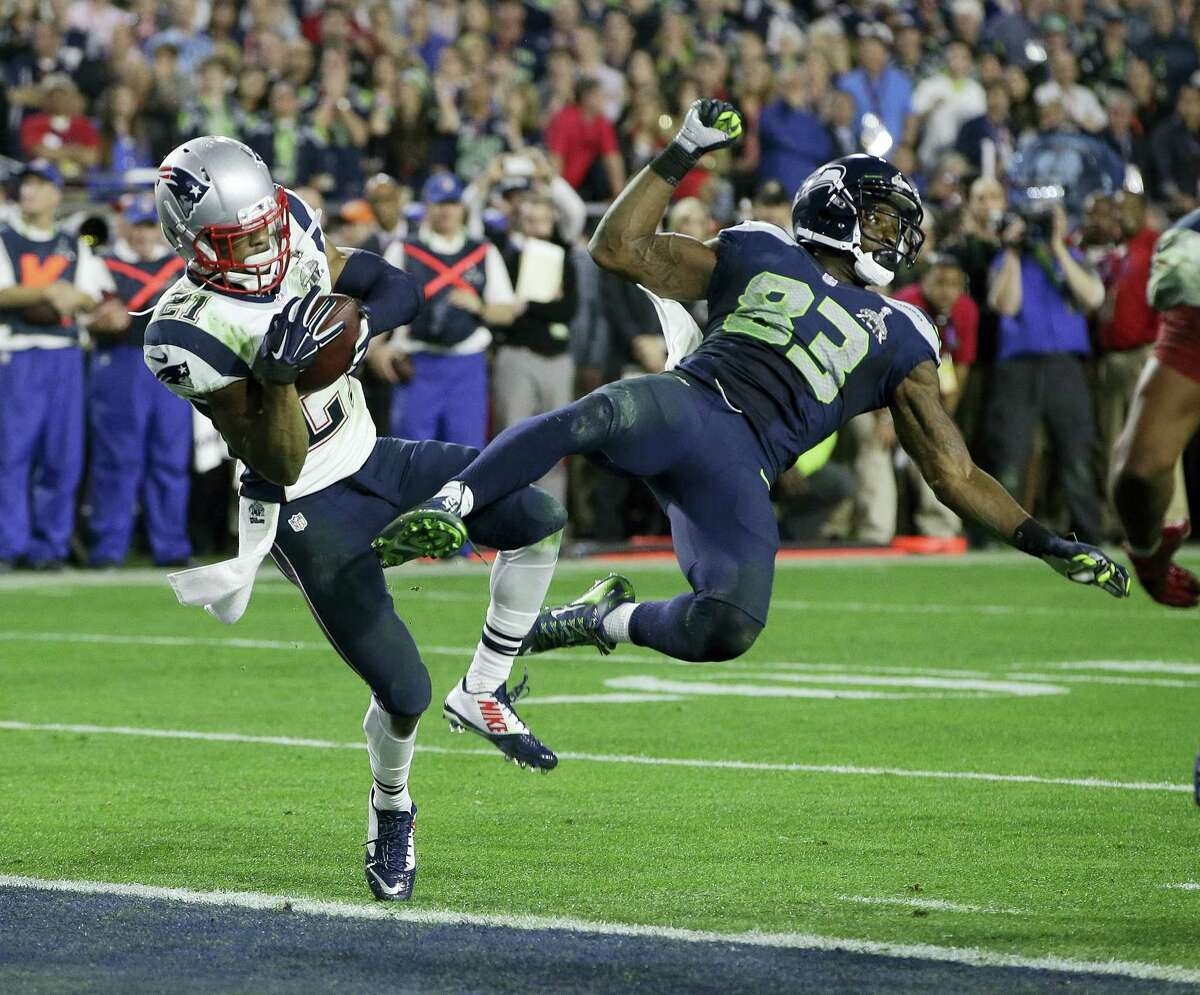 In this file photo, New England Patriots strong safety Malcolm Butler (21) intercepts a pass intended for Seattle Seahawks wide receiver Ricardo Lockette (83) during the second half of NFL Super Bowl XLIX football game in Glendale, Ariz. The Patriots restricted free agent cornerback Malcolm Butler has scheduled a visit with the New Orleans Saints at the team'Äôs headquarters on Thursday according to Saints coach Sean Payton.