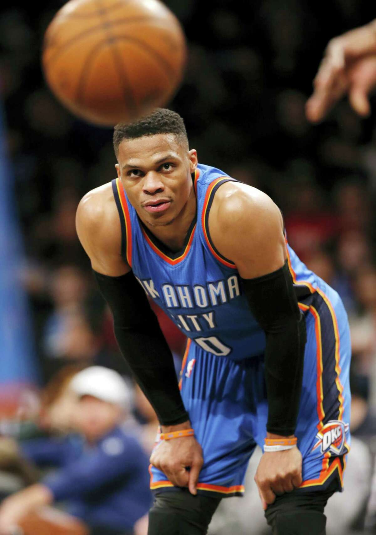 Oklahoma City Thunder guard Russell Westbrook (0) watches as a referee throws the ball to a Thunder player for a free throw in the second half of an NBA basketball game against the Brooklyn Nets, Tuesday, March 14, 2017, in New York. Westbrook had a triple double with 25 points, 19 assists and 11 rebounds as the Thunder defeated the Nets 122-104. (AP Photo/Kathy Willens)