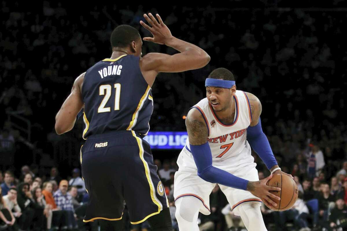 Indiana Pacers' Thaddeus Young (21) defends New York Knicks' Carmelo Anthony (7) during the second half of an NBA basketball game Tuesday, March 14, 2017, in New York. The Knicks won 87-81(AP Photo/Frank Franklin II)